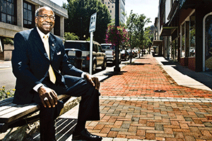 Mayor Sherman Saunders, a proponent of downtown revitalization, is surrounded by recently completed sidewalk and landscape additions on Main Street.