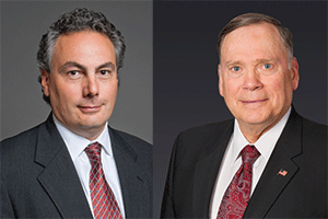Tony Moraco (left), CEO of SAIC; and John Jumper, Chairman and CEO of Leidos