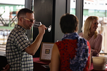 An attendee samples wine from The Barns at Hamilton Station Vineyards during the 2020 Governor's Cup event. Photo by Megan Lee/Capital News Service.